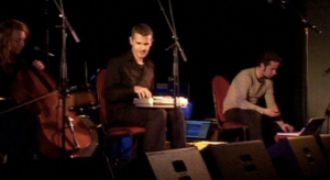 Panoptique Electrical at Thornbury Theatre, Melbourne 11/4/09, Jed Palmer (out of shot), Zoe Barry (cello), Jason Sweeney (keys), Tristan Louth-Robins (touch, laptop & bad posture)